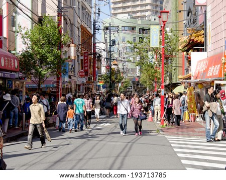YOKOHAMA, JAPAN - Oct 13 : People shopping in China Town in Oct 13, 2013, being the third largest Chinatown throughout Japan