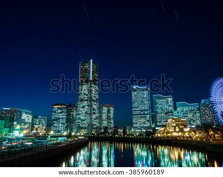 Yokohama Minato Mirai 21 buildings and live composite star trails - stock photo