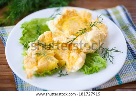 yolk baked into the beaten egg whites with cheese