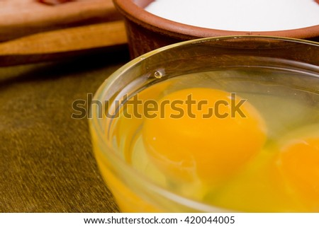 Yolks and whites of eggs broken in a glass - stock photo