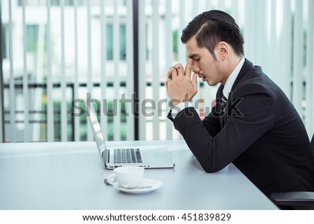 Yong business man to think and not Work with stress Pretending to put his hand to the head.Tired overworked businessman at office covering her face with hands - stock photo