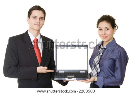 Yong businessman and young businesswoman with laptop - stock photo