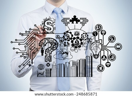 yong businessman drawing business startegy - stock photo