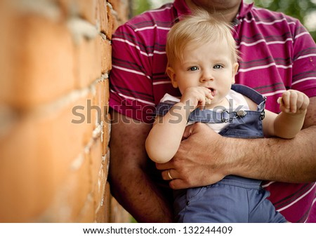 Yong family is enjoying a day on the farm - stock photo