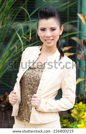 Yong girl fashion post to photographer in garden  - stock photo