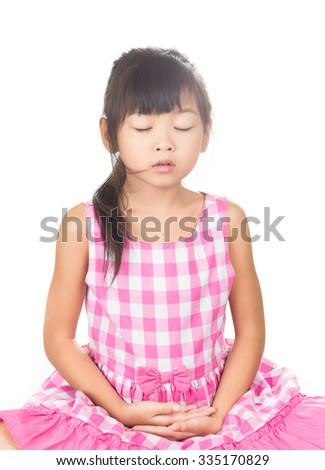 Yong girl meditating on a white background.