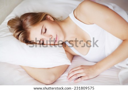 yong girl sleeping in the bed - stock photo