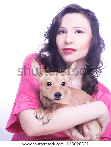 Yong happy woman posing with little dog