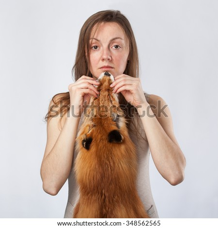 yong lady carrying fox pelt - stock photo