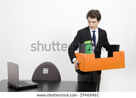 Yong manager fired from his job - stock photo