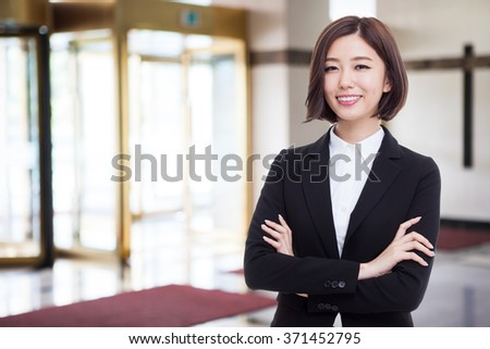 Yong pretty Asian business woman isolated on business background. - stock photo