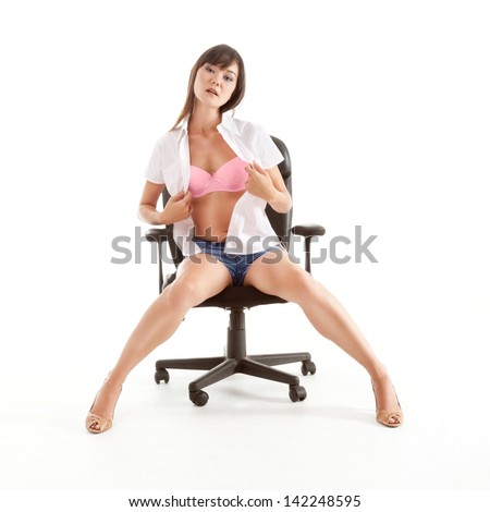 Yong sexy sensual Japanese woman stripper undressing while performing striptease - stock photo