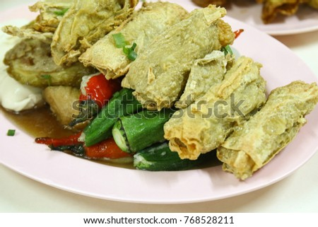 Yong Tau Foo, a Hakka Chinese cuisine consisting of tofu and vegetables stuffed with ground meat mixture or fish paste.