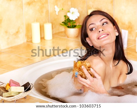 Yong woman bathing in bathroom - stock photo