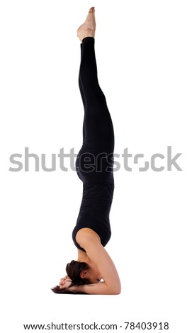 yong woman exercise yoga supported headstand  stock photo