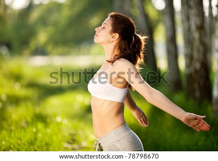Yong woman getting pleasure from nature. - stock photo