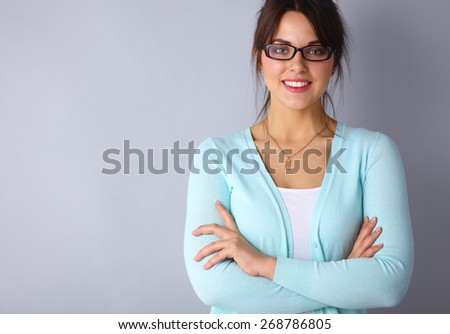 Yong woman standing with arms crossed  - stock photo