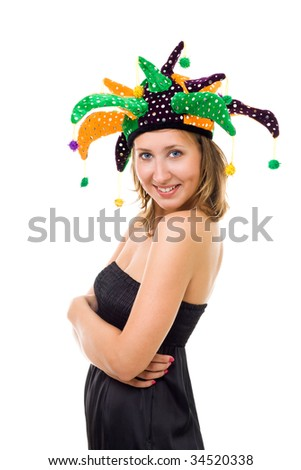 Yong woman woman in funny party hat with wide smile looking at camera - stock photo