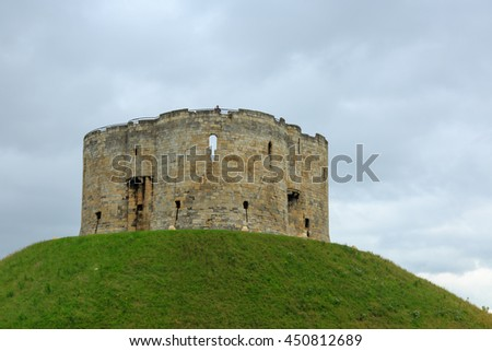 York, England - 7 July, 2016: Clifford's Tower, in York, dates from the mid 17th century and is open to the public. From its upper ramparts visitors gain commanding views over most of the city