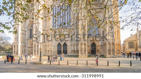 YORK, ENGLAND - JULY 16: Front view of York Minster in York, England, on July 16, 2015. York Minster is a cathedral in York and is one of the largest of its kind in Northern Europe. - stock photo