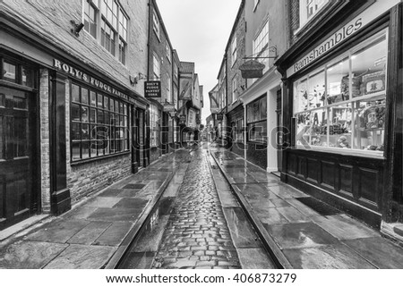YORK, UK - April 12: The Shambles is a former butchers' street in York with some buildings dating back from the fourteenth century. April 12, 2016 in York. - stock photo