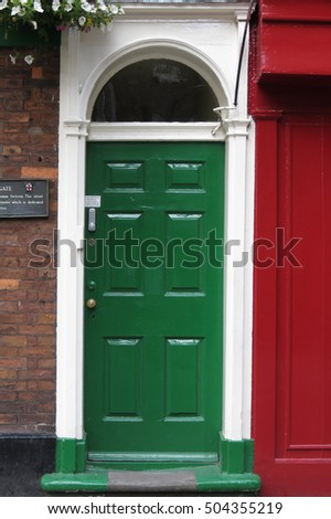 YORK, UK - CIRCA AUGUST 2015: Detail of a traditional coloured British door painted in green