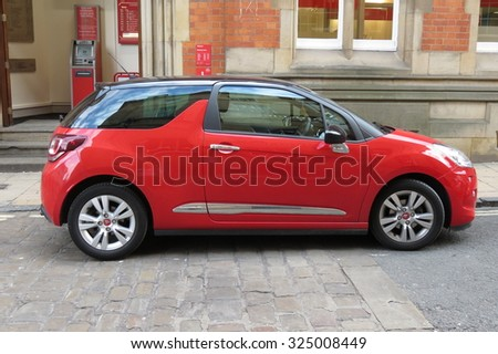 YORK, UK - CIRCA AUGUST 2015: red Citroen DS3 car in a street of the city centre. - stock photo