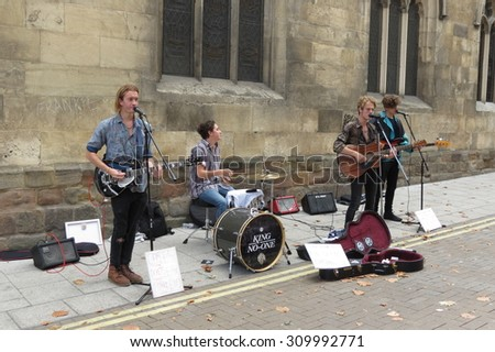 YORK, UK - CIRCA AUGUST 2015: rock band King No-one performing on a street of the city centre - stock photo