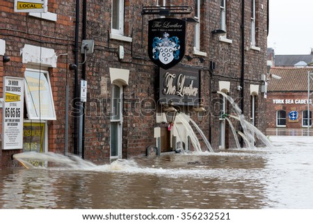 YORK, UK - DECEMBER 28th 2015: Flooded streets of King's Staith in York City Centre after heavy rain, on 28th December  2015.