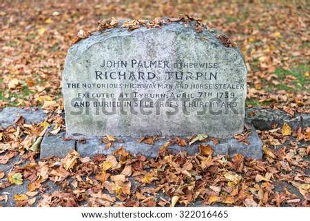 YORK, UK - SEPTEMBER 28TH 2014: The Grave of notorious Highwayman Dick Turpin in York, on 28th September 2014. - stock photo