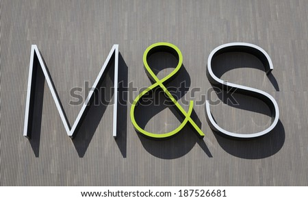 YORK, UNITED KINGDOM â� APRIL 15, 2014: Marks&Spencer sign on the wall of the M&S store in York, UK. Marks&Spencer plc is a British retailer specializing in selling food, clothing and home products. - stock photo