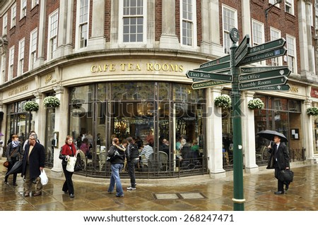 YORK, UNITED KINGDOM - APRIL 19TH:  Rainy day in York, England. The famous Betty's Tea Rooms at Helenas Square, York, North Yorkshire, United Kingdom on April 19, 2010 - stock photo