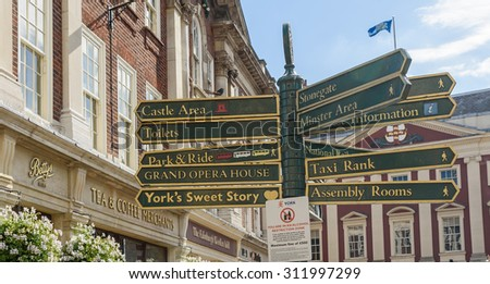 YORK, YORKSHIRE, UK. July16, 2015. A tourist signpost in the center of the city of York, Yorkshire, UK. - stock photo