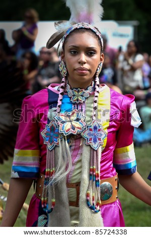YORKTOWN HEIGHTS, NY - SEPTEMBER 25: Unidentified Native American Indian woman dances at the FDR  Pow Wow on September 25, 2011 in Yorktown Heights, NY - stock photo