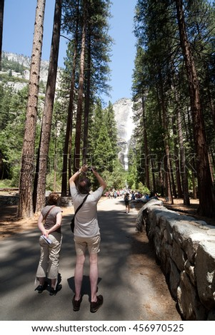 YOSEMITE, CA - MAY 23: Tourists walk the trail up to Yosemite Falls on May 23, 2009 in Yosemite, CA.  Yosemite National Park proves to be a favorite destination in these cash strapped times.