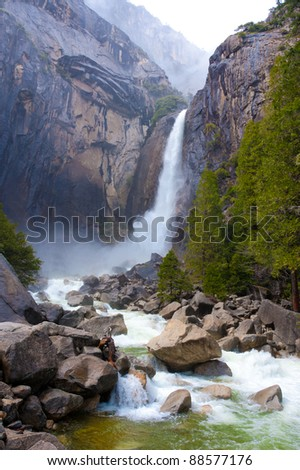 Yosemite lower fall in spring with a powerful water flow.