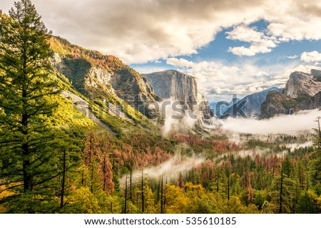 Yosemite National Park Valley at cloudy autumn morning from Tunnel View. Low clouds lay in the valley. California, USA