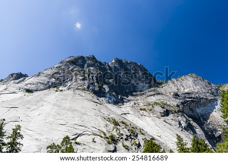 Yosemite Valley with a view of a rock formation under a clear blue sky, in Yosemite National Park, California, USA - stock photo