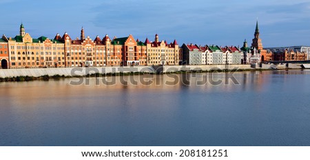 YOSHKAR-OLA, RUSSIA - SEPTEMBER 16, 2013: Beautiful houses on river Kokshaga in the city of Yoshkar-Ola on september 16, 2013. Russia - stock photo