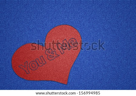 You and Me Heart Shape - Red heart shaped patch on blue in jeans fabric look and text You and Me in stitching effect for Valentine's day, lovers and love and everything connected to love. - stock photo