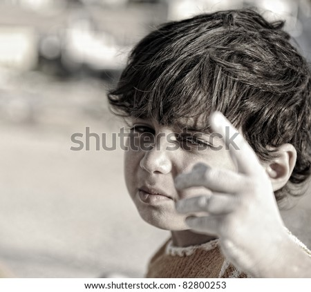 You are also responsible for this! Poor child with finger up. - stock photo