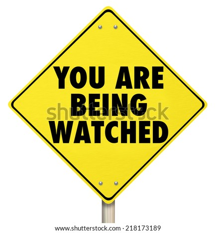 You Are Being Watched words on a yellow warning sign as a violation of privacy or security protection to prevent crime - stock photo