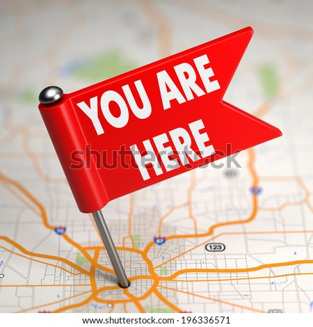 You Are Here Concept - Small Flag on a Map Background with Selective Focus. - stock photo