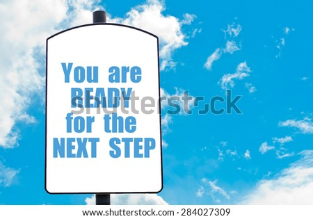 You Are Ready For The Next Step  motivational quote written on white road sign isolated over clear blue sky background. Concept  image with available copy space
