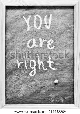 You are right written with Chalk on Blackboard - stock photo