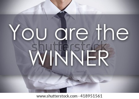 You are the WINNER - Closeup of a young businessman with text - business concept - horizontal image