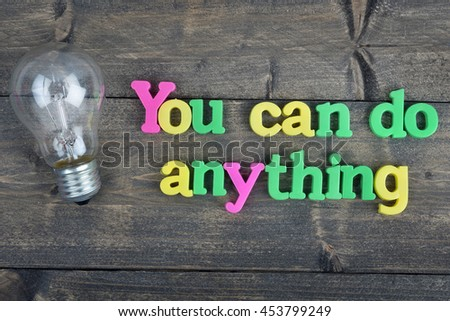 You can do anything word on wooden table - stock photo