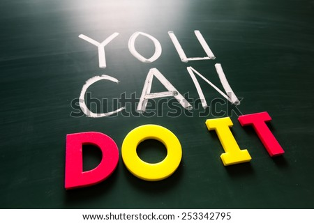 You can do it concept, colorful words on blackboard
