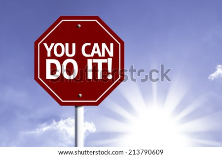 You Can Do IT! red sign with sun background  - stock photo