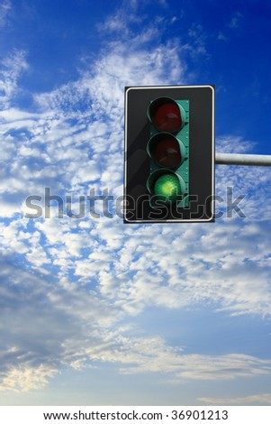 You can go: green light on traffic light - stock photo